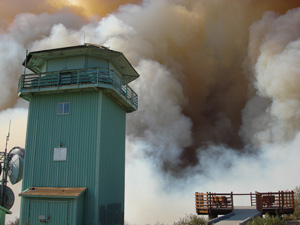 Poomacha fire smoke behind Boucher Hill lookout tower and view platform