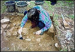 Patricia Petersen excavating unit near the location of the apothecary store.