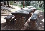 WPA built stone picnic table at Marshall Gold SHP
