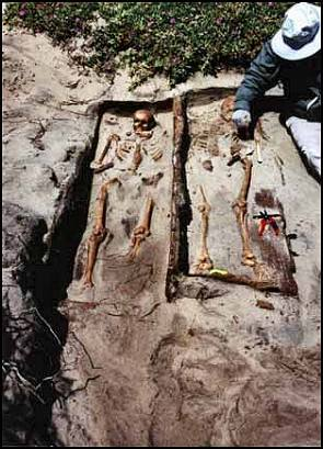 Peter Schulz next to the exposed human remains