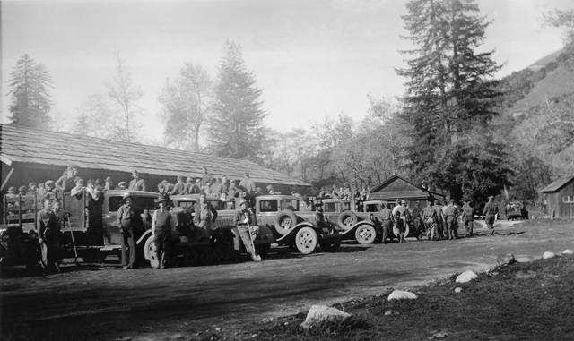 Camp Big Sur men and trucks in motor pool 1936
