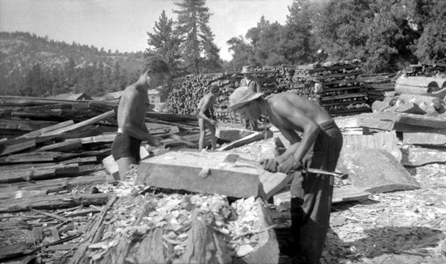 CCC crew hewing picnic table tops in 1934