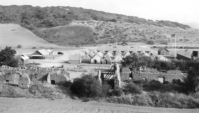 The CCC setting up camp at the La Purisima Mission in 1934 The camp tents can be seen behind the mission ruins.