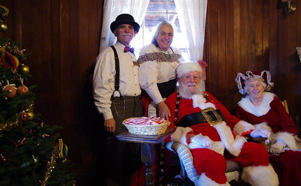 AMIA Board members Henry Bornstein & Gae Henry with Santa & Mrs. Claus image