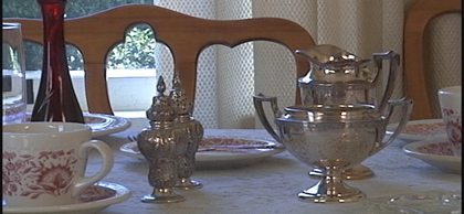 China and silver on the Formal Dinnig Room Table of the Mansion.