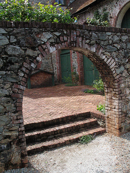 Brick Arch leading to Bourn Mansion