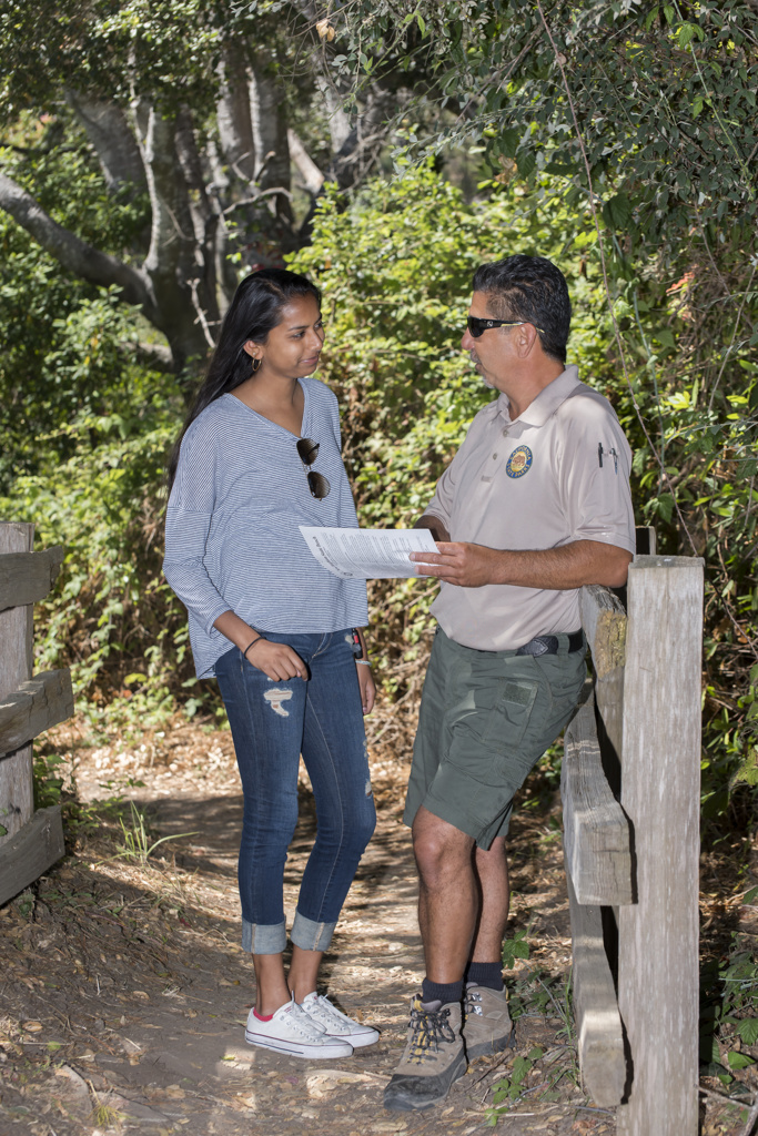 park employee and visitor having a conversation