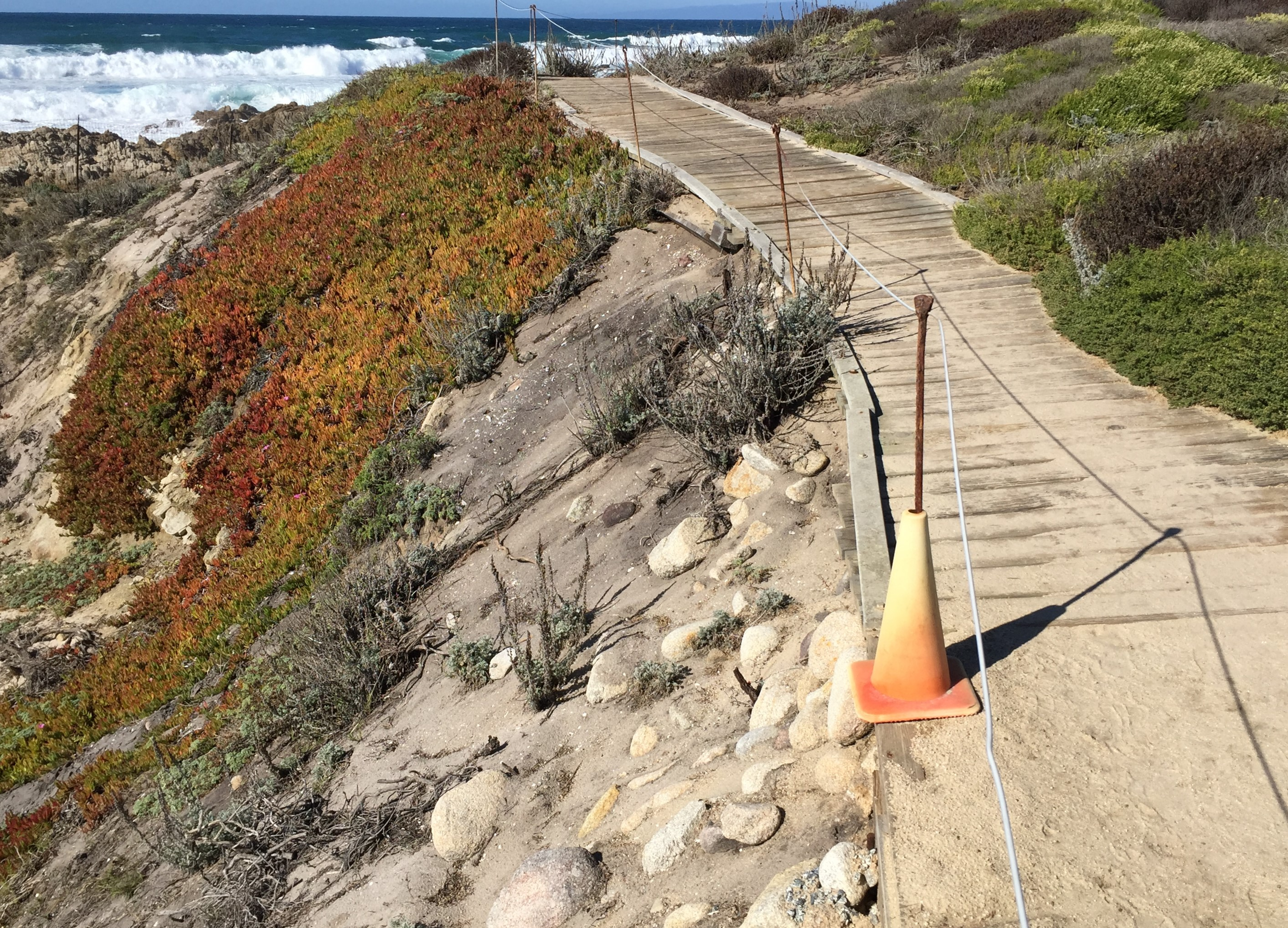 Current boardwalk section with erosion