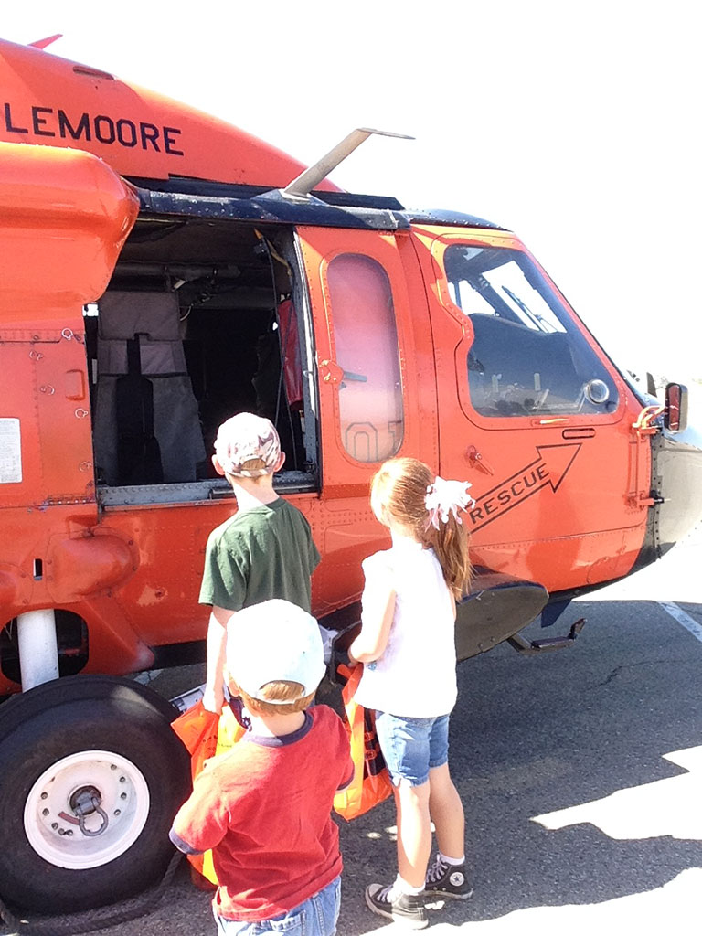 Children viewing a helicopter