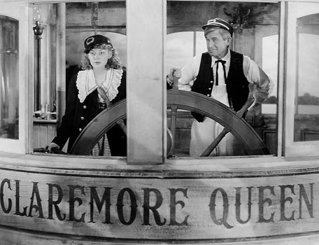 "Will Rogers and Anne Shirley in ""Steamboat 'Round The Bend"""