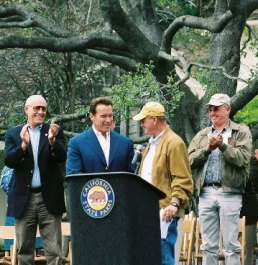 Chuck Rogers presenting Governor Schwarzenegger with deed to Will Rogers SHP. (Photo by Marc Holmes)