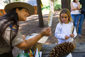 interpreter showing feathers to girl