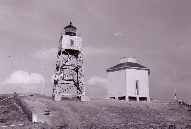 Steel light tower adjacent to tank house, circa late 1940's
