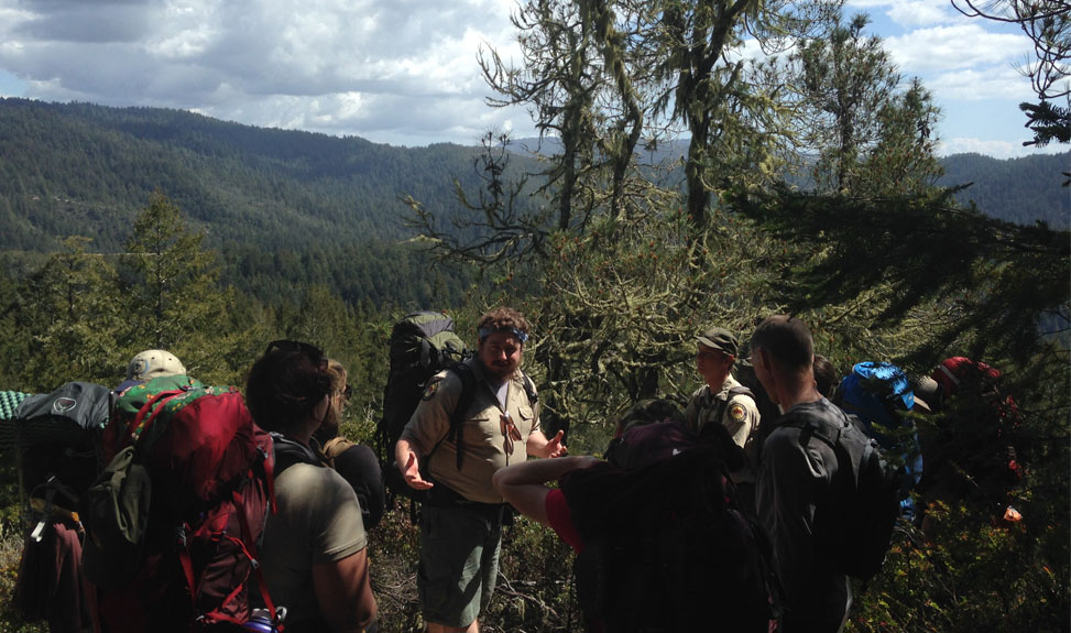 Backpacking Image Ranger speaking to group