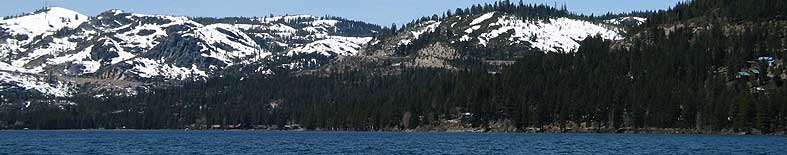 Thumbnail: View of Donner Lake shoreline and snow capped mountains at Donner Memorial SHP