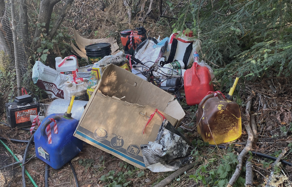 Some of the 1,000 lbs. of trash found at the site including gasoline and fertilizer.