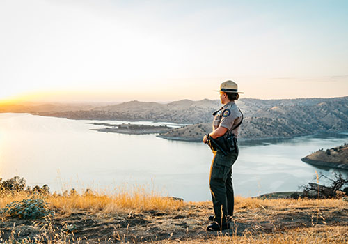 Ranger at Lake Millerton during sunset